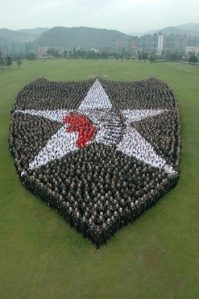 Approximately 5,000 Warriors from the 2nd Infantry Division form a human version of the distinctive Indian-Head patch Thursday morning (May 21) at Indian-Head Stage Field on Camp Casey, South Korea. (Photo by Maj. Vance Fleming)