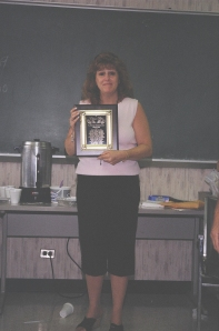 NMIAI Jun 09 Graduation: Elaine Preto, Instructor is presented with a plaque.